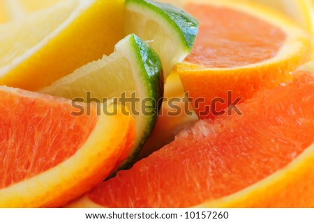 Wedges of assorted citrus fruits lemon orange and lime
