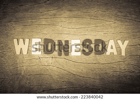 Wednesday letters on cracked wood background