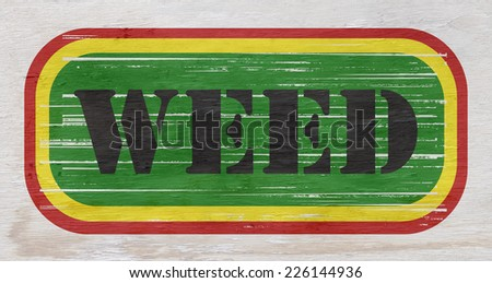 weed sign on wood grain texture - stock photo