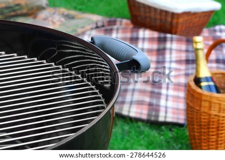 Weekend Barbecue Picnic Scene With Wine In Basket And Grill