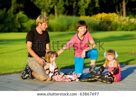 Weekend for a young sportive family - stock photo
