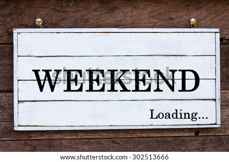 Weekend Loading Inspirational message written on vintage wooden board. Motivation concept image