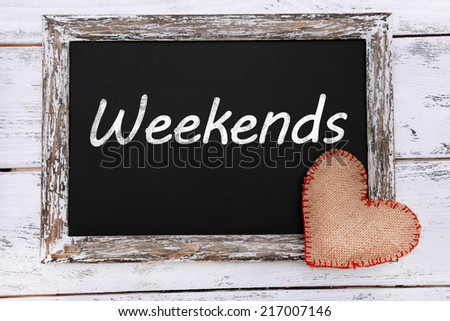 Weekends written on chalkboard, close-up - stock photo