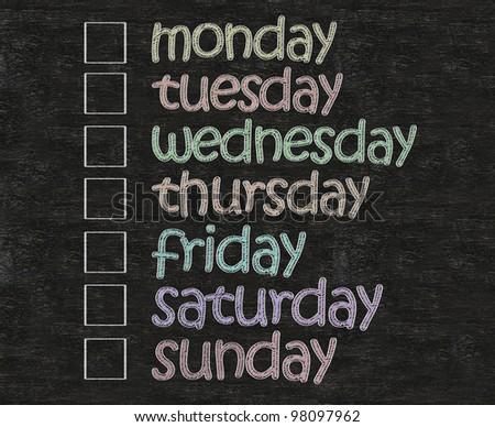 weekly days plan with box written on blackboard background - stock photo