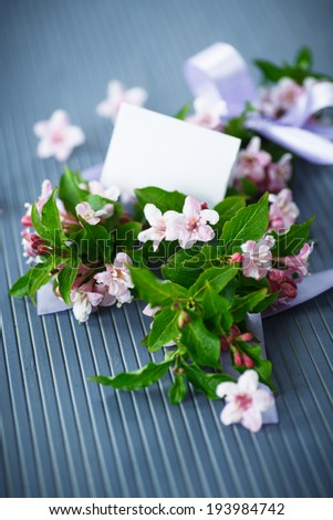 Weigel beautiful pink flowers on wooden table