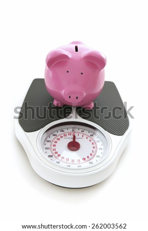 Weigh in - Piggy Bank on White Background on scales - stock photo