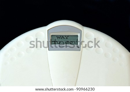 "weighing machine with ""way to go!"" written in the display"
