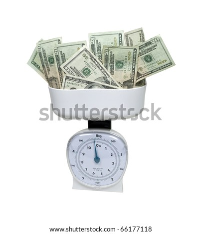 Weighing money shown by a basket scale filled with money - path included - stock photo