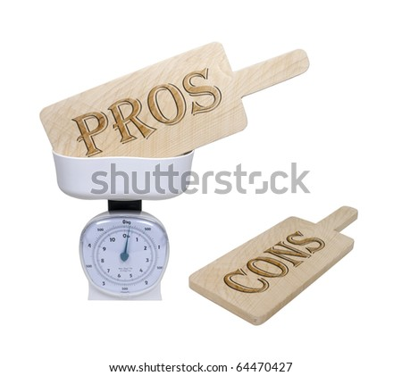 Weighing pros and cons shown by pro and con wooden signs in a basket scale - path included - stock photo