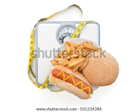 Weighing scales bad diet - stock photo