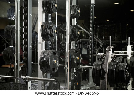 Weight lifting equipments in a club gym. - stock photo