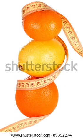 Weight loss and healthy dieting concept. Orange, lemon and mandarin with measure tape. Isolated over white. - stock photo