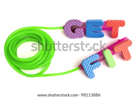 Weight loss concept - colorful sign with alphabet puzzle letters and a jump rope isolated on white background - stock photo