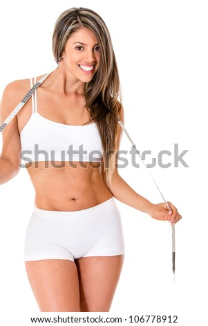Weight loss concepts with a fit woman smiling - isolated over white
