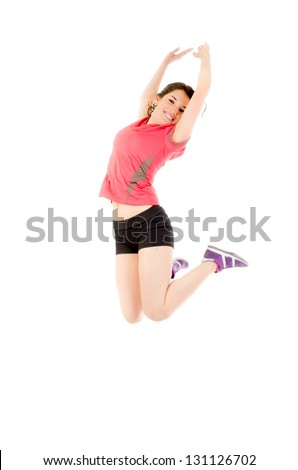 Weight loss fitness woman jumping of joy. Young sporty fit mixed race Latin / Caucasian - stock photo