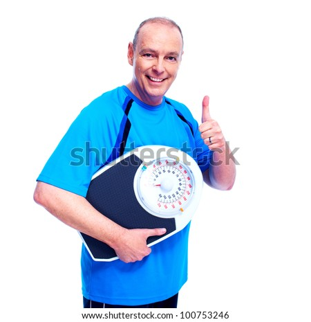 Weight loss. Happy senior man with scales. Isolated over white. - stock photo