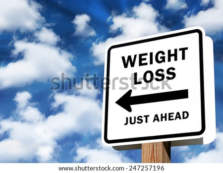 Weight Loss just ahead sign as business concept on a sky background - stock photo