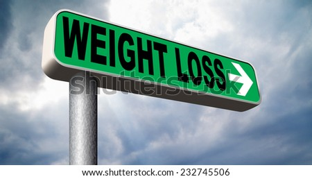 weight loss loosing extra kilos by exercise sport and a healthy diet - stock photo