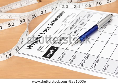 Weight Loss Schedule with Tape Measure - stock photo
