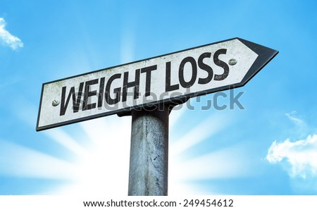 Weight Loss sign with a beautiful day - stock photo
