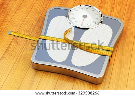 Weight loss, slimming, diet, and healthy lifestyle concept, yellow measuring tape wrapped around bathroom scales on wooden floor - stock photo