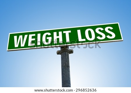 WEIGHT LOSS word on green road sign - stock photo