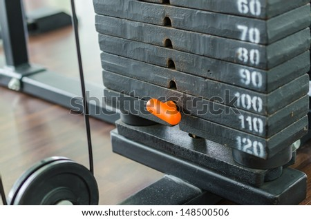 Weight plate for exercise in fitness room - stock photo
