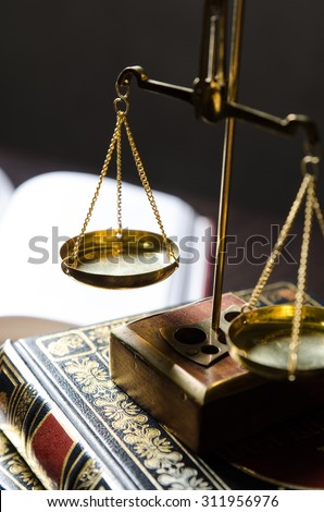 Weight scale and books. Scales of Justice and law concept - stock photo