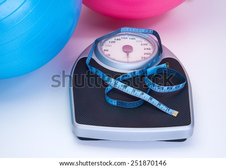 Weight scale and fitness  workout gear - stock photo