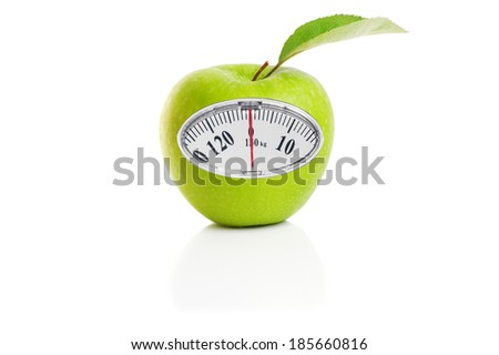 Weight scale on an green apple, diet concept - stock photo