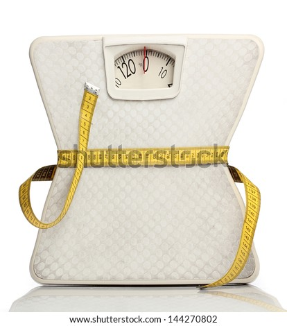 Weight scale with a measuring tape over white - stock photo