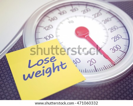 Weight scale with reminder to lose weight. Depth of field with focus on the reminder.
