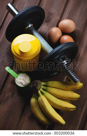 Weight training and nutrition. High angle view, selective focus - stock photo