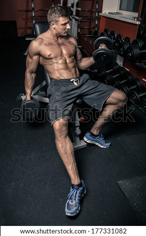 Weightlifter sitting in a gym