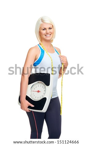 weightloss woman with scale showing diet and exercise concept - stock photo