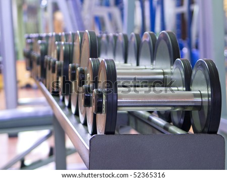 Weights in gym - stock photo