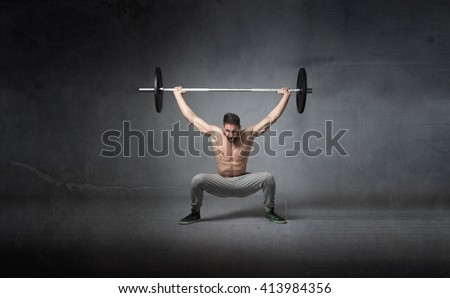 weights lifting for athlete, dark background - stock photo