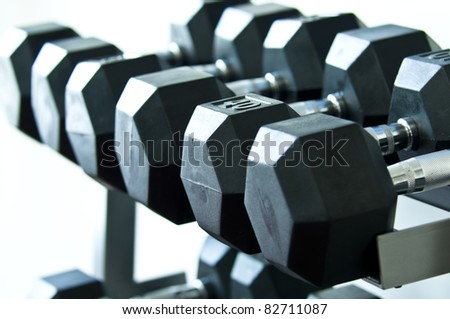 Weights of a gym different sizes and weights black - stock photo