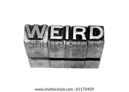 WEIRD written in metallic letters on a white background - stock photo