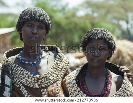 WEITA. OMO VALLEY. ETHIOPIA - DECEMBER 29, 2013: Traditionally dressed unidentified women from Tsemay tribe. Most Omo Valley people maintain their traditional way of life.  - stock photo
