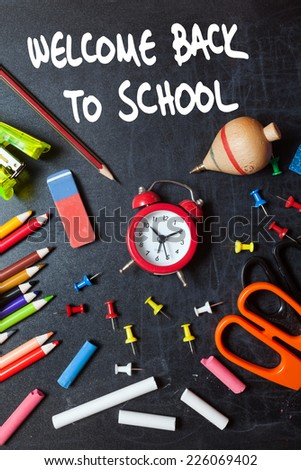 Welcome back to school. School tools around. Blackboard background. - stock photo