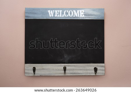 welcome chalk board on the wall - stock photo