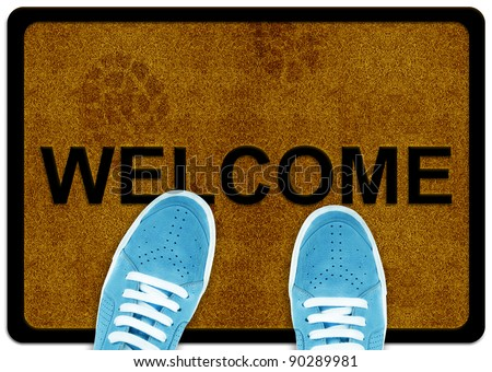 welcome cleaning foot carpet with shoes and shoe print on it. - stock photo