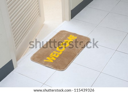 Welcome doormat in front of the rest room - stock photo