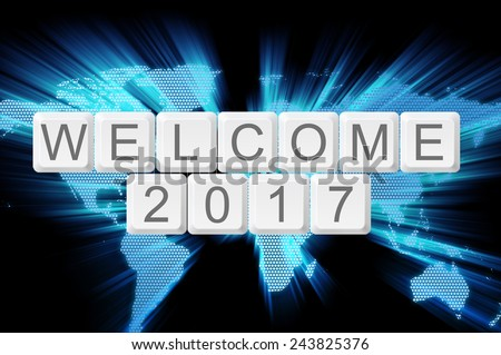 Welcome 2017 from keyboard button with shiny world background - stock photo