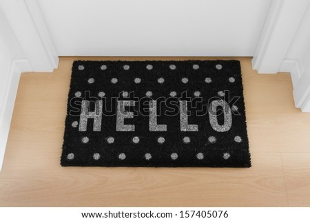 Welcome home black mat. Hello - stock photo