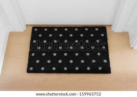 Welcome home doormat with close door  - stock photo
