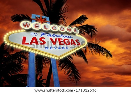 Welcome in Vegas. Las Vegas Entrance Sign, Palms and Sunset. Las Vegas, Nevada, United States. - stock photo