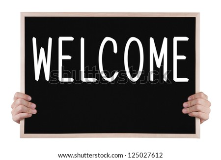 welcome on blackboard with hands - stock photo