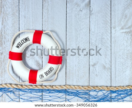 Welcome on Board - Lifebuoy with text on wooden background with copyspace for individual text - stock photo